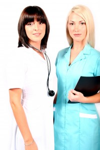 Beautiful brunette female doctor and nurse